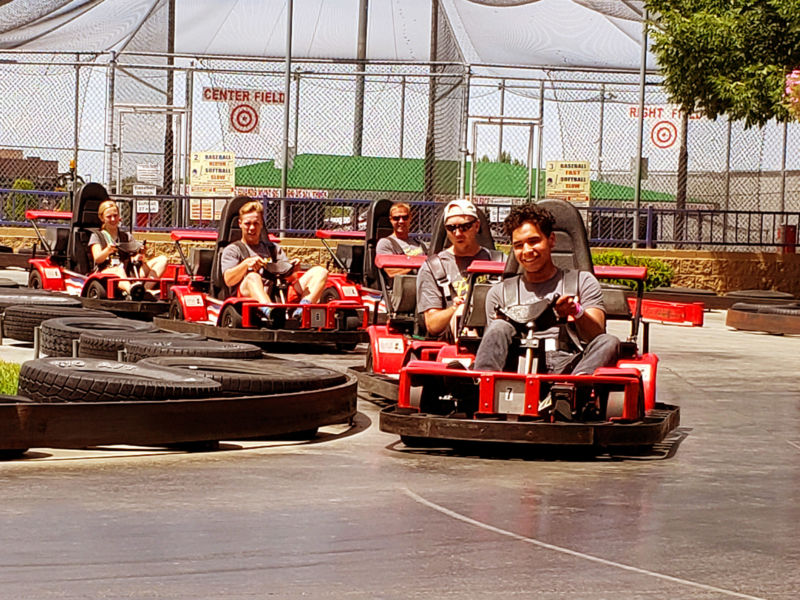 children driving bumper cars